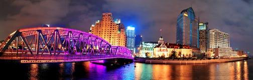 Shanghai Waibaidu bridge. Panorama at night with colorful light over river Stock Photos