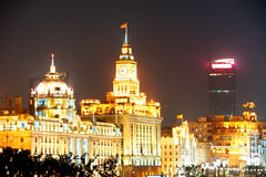 Shanghai Waitan. District with historic buildings at night Stock Images