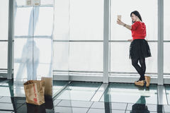 Shanghai World Financial Center building Observatory. SHANGHAI, CHINA - MAY 07, 2016: Girl taking selfie in Shanghai World Financial Center building Observatory royalty free stock images