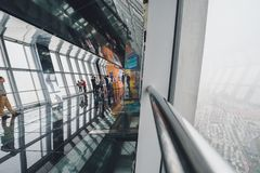 Shanghai World Financial Center building Observatory. SHANGHAI, CHINA - MAY 07, 2016: Tourists in Shanghai World Financial Center building Observatory royalty free stock photo