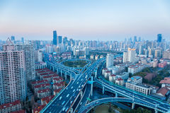 Shanghai yanan west road intersection at dusk. Modern city skyline and transport Royalty Free Stock Photo