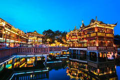 Shanghai yuyuan garden with reflection in the lake at night,China. Stock Photo