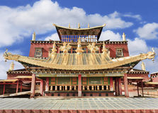 Shangri-la Buddhist temple against a blue sky with dramatic clouds. The famous Shangri-la Buddhist temple against a blue sky with dramatic clouds stock photography