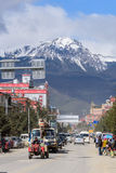 SHANGRI-LA, CHINA. SHANGRI-LA, CHINA - April 20, 2016:Traffic intersection in the Shangri-la city with the snow mountains background Royalty Free Stock Image
