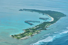 Shangri-La's Villingili Resort and Spa - Aerial Maldives. As you stroll along the resort's edge, the vast Indian Ocean stirs a sense of awe deep within you Stock Photos