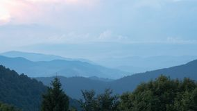 Shank of the evening in Carpathians mountains at summer, west Ukraine. Ukrainian nature panoramic landscape. Hillsides. Covered with dense forest. Dark ranges royalty free stock photography
