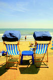 Shanklin beach, Isle of Wight. Empty deckchairs and table make a tempting relaxing break on the Promenade at Shanklin, Isle of Wight, England, UK Stock Photography