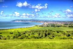 Shanklin and Sandown Isle of Wight coast in vivid and bright HDR. Isle of Wight coast view towards Shanklin and Sandown from Culver Down in striking colourful Royalty Free Stock Photo