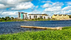 Shannon river with calm waters, some buildings in the city of Athlone in the background. Wonderful spring day in the county of Westmeath, Ireland stock photos