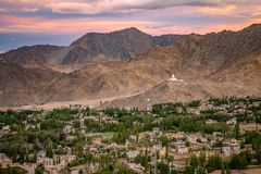 View of Shanti Stupa on a hilltop in Chanspa from Leh Palace in Leh district, Ladakh. Shanti Stupa is a Buddhist white-domed stupa chorten on a hilltop in royalty free stock image