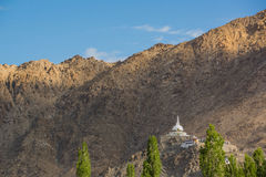 Shanti Stupa,Leh Ladakh.Light and shade from sunrise. Shanti Stupa is a Buddhist white-domed stupa on a hilltop in Chanspa, Leh district, Ladakh, in the north Stock Image
