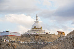 Shanti Stupa,Leh Ladakh.Light and shade from sunset.Blur on fore. Shanti Stupa is a Buddhist white-domed stupa on a hilltop in Chanspa, Leh district, Ladakh, in Stock Images