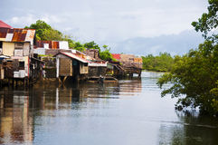 Shanties on river Stock Photos