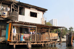 Shanty House by river at Bangkok Stock Photography