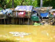 Shanty huts along river. Cambodian shanty huts along river Stock Photo
