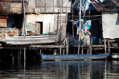 Shanty squatter homes along Philippine river Royalty Free Stock Images
