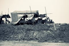Shanty, Tonle Sap, Siem Reap, Cambodia. Shanty homes on Tonle Sap waterfront in black and white, Siem Reap, Cambodia Stock Photos