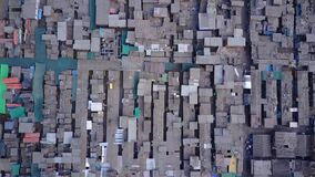 Shantytown in Lima. Poor families living in wooden precarious houses.