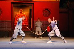 Shaolin Kung fu. Qigong, a system of deep breathing exercises which can make the weakest point on human body like throat stronger than the sharp weapon。Shaolin Royalty Free Stock Images