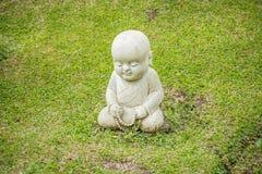 Shaolin Monk Statue in a Garden. Little Shaolin Monk Statue in a Garden with beads stock photography