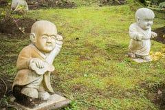 Shaolin Monk Statue in a Garden Practice Kung Fu. Little Shaolin Monk Garden Statue in a Garden. Shaolin Monk Statue Practice Kung Fu stock image