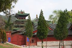"Shaolin Temple in Songshan. Shaolin Temple is located in Songshan, five, Dengfeng, Zhengzhou, Henan. It is called ""Shaolin Temple"" because it is Stock Image"
