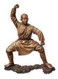 Shaolin warriors monk bronze statue. Shaolin warriors monk in Chinese Temple Viharn Sien, Chonburi, Thailand. Bronze statue isolated on white with clipping path royalty free stock photo