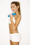 Shape IT!. Young beautiful woman during fitness time and exercising Royalty Free Stock Photography