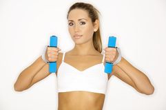 Shape IT!. Young beautiful woman during fitness time and exercising Royalty Free Stock Image