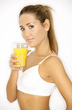Shape IT!. Young beautiful woman with glass of orange juice Stock Photos