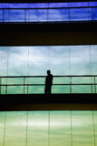 Shape. Worker inside the modern building in silhouette Stock Photo