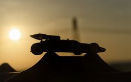 Shape of beautiful single-seater. With sunset in background royalty free stock photo