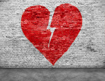 Shape of broken heart. Painted on brick wall stock photo