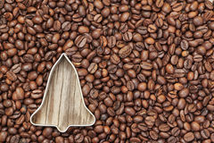 Shape of a Christmas bell in coffee beans. Royalty Free Stock Image
