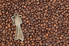 Shape of a Christmas star in coffee beans. Royalty Free Stock Photography