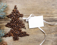 Shape of christmas tree made of coffee beans Royalty Free Stock Photo
