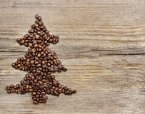 Shape of christmas tree made of coffee beans Royalty Free Stock Images