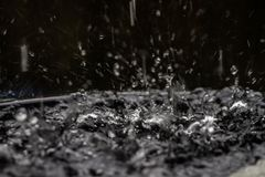 Shape description has not been caused by rain water falling. Make it a natural beauty. Abstract image of Heavy rains cause a splash without a format royalty free stock photography