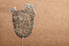 Shape of easter chicken made of silver wire Royalty Free Stock Photos