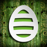 Shape of Easter egg on green wooden background Royalty Free Stock Photography