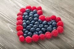 Fresh ripe berries in heart shape on white. Shape fresh heart berries healthy lifestyle low calorie natural food Stock Images