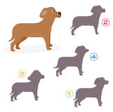 Shape game - the dog. A funny game for children: Find the exact shape of the dog! (The right solution is number one Royalty Free Stock Photo