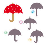 Shape game - the umbrella. A funny game for children: Find the exact shape of the umbrella! (The right solution is number four Royalty Free Stock Photo