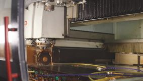 The shape of the glass is cut on the machine. In factory stock video footage