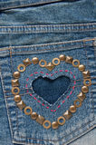Shape of heart on denim fabric Royalty Free Stock Image