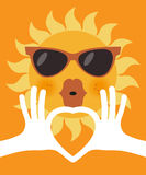 The shape of heart in human hands and cartoon  sun in glasses Stock Photography