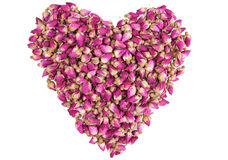 Shape of a heart made out of dried roses. Shape of a heart made out of dried pink roses isolated on white Stock Image