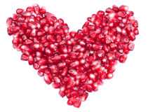 Shape of a heart made out of pomegranate seeds Stock Photography