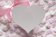 Shape of heart, pink bow and hearts in background Stock Photo