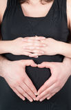 Shape of heart on pregnant tummy Stock Image